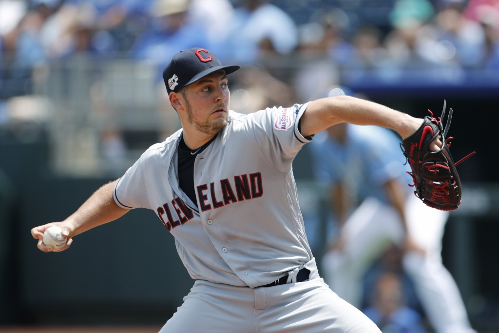 Cleveland Indians pitcher Trevor Bauer throws against the Kansas City Royals in the first inning of a baseball game at Kauffman Stadium in Kansas City...