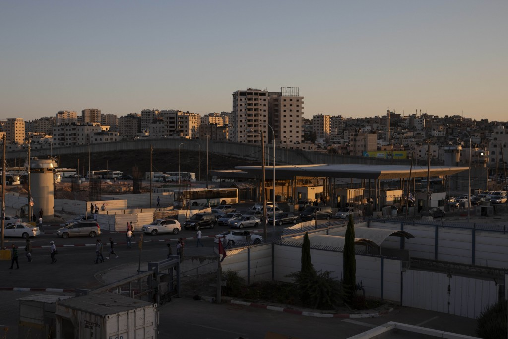 In this Thursday, July 11, 2019 photo, cars pass the Qalandia crossing between the West Bank city of Ramallah and Jerusalem. Israel's military has inv