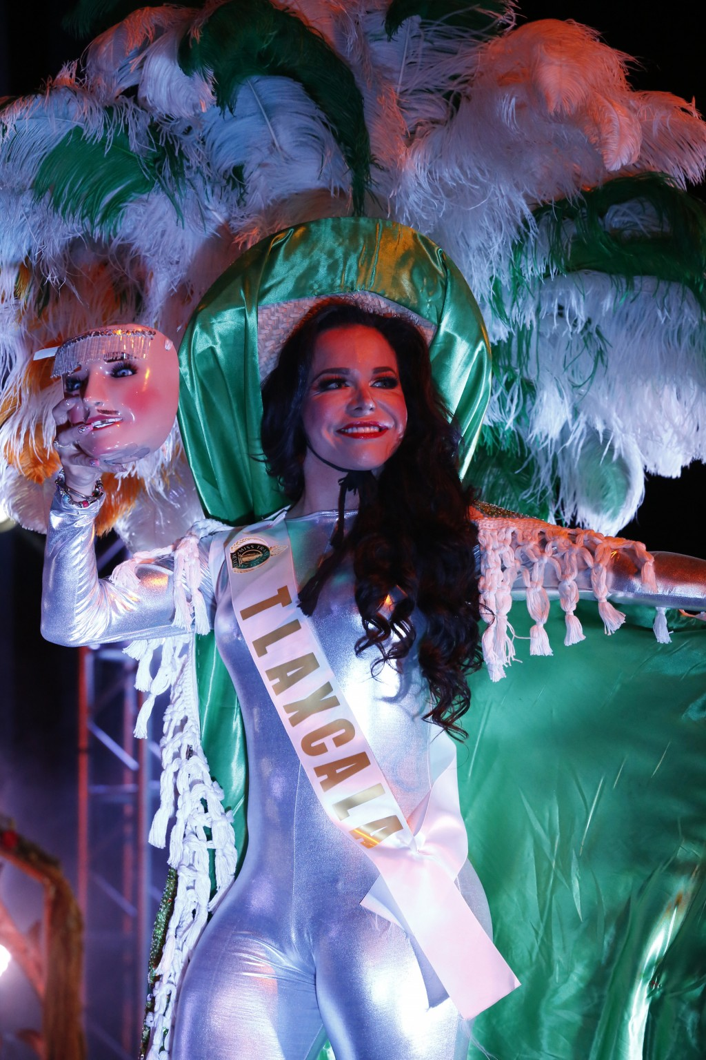A contestant in the Miss Transgender Beauty pageant from the state of Tlaxcala wears a regional contest as she competes in Mexico City, Saturday, July...