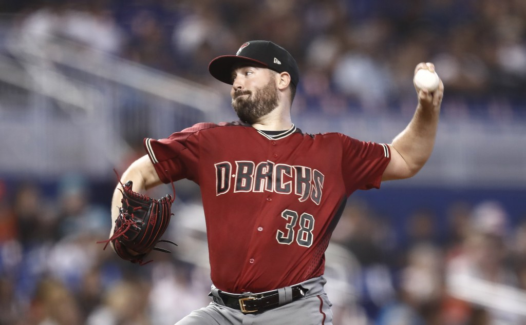 Arizona Diamondbacks starting pitcher Robbie Ray delivers during the first inning of a baseball game against the Miami Marlins on Sunday, July 28, 201...
