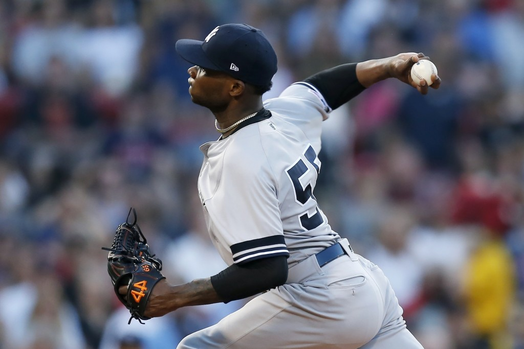 New York Yankees' Domingo German pitches during the first inning of a baseball game against the Boston Red Sox in Boston, Sunday, July 28, 2019. (AP P...
