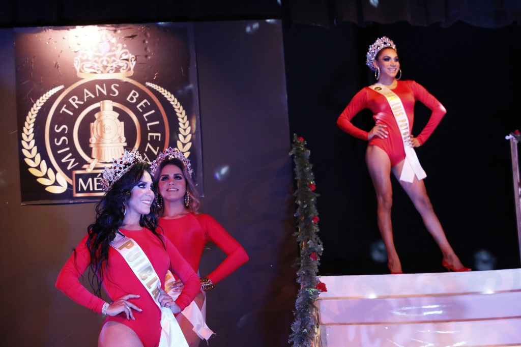 Contestants in the Miss Transgender Beauty pageant, from the Mexican states of Puebla, front left, and Colima stand during the opening event in Mexico...