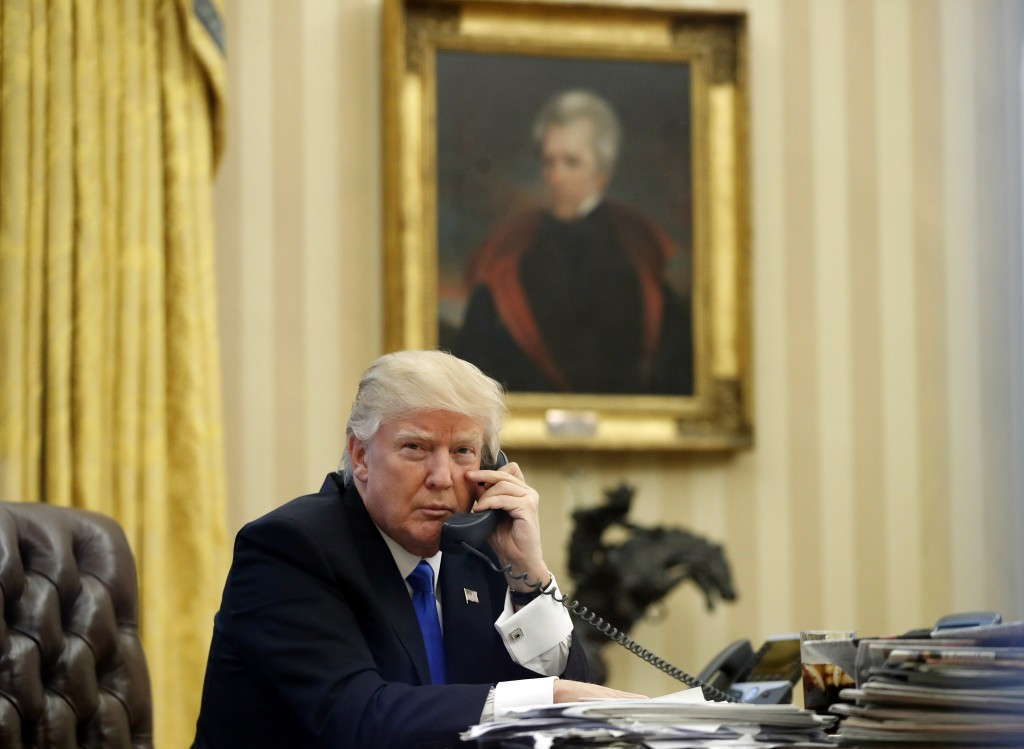 FILE - In this Saturday, Jan. 28, 2017 file photo, President Donald Trump speaks on the telephone with Australian Prime Minister Malcolm Turnbull in t...