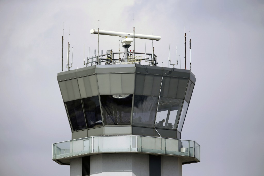 FILE - This March 12, 2013 photo shows the air traffic control tower at Chicago's Midway International Airport.  The Department of Homeland Security p...