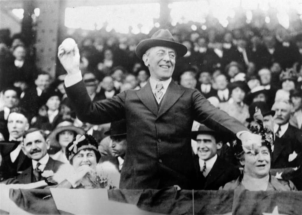 FILE - In this 1916 file photo, President Woodrow Wilson throws out the first ball at a baseball game in Washington. Wilson drew criticism in 1915 for...