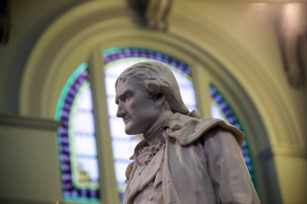 FILE - This Feb. 17, 2016 file photo shows statue of Thomas Jefferson greeting visitors in the main lobby of the Jefferson Hotel in Richmond, Va. Jeff...