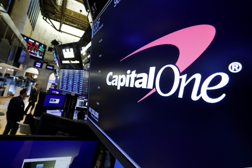 FILE - In this Tuesday, July 30, 2019, file photo, the logo for Capital One Financial appears above a trading post on the floor of the New York Stock ...
