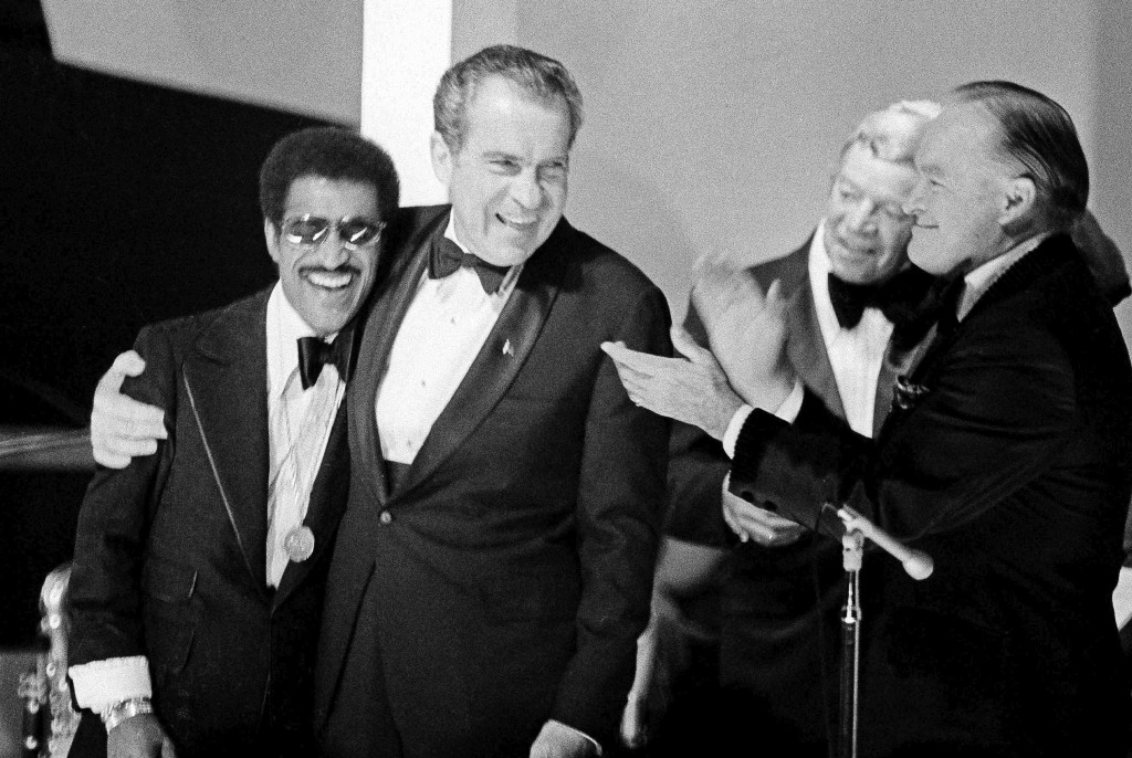 FILE - In this May 25, 1973, file photo, President Richard Nixon embraces Sammy Davis Jr. during festivities at the White House where about 450 former...