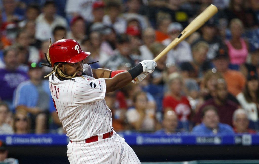 Philadelphia Phillies' Maikel Franco hits an RBI ground ball to score J.T. Realmuto during the fourth inning of a baseball game against the San Franci