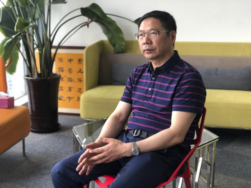 In this July 24, 2019, photo, Prof. Du Huanzheng, director of Research Institute of Recycled Economy at Tongji University, speaks during an interview ...