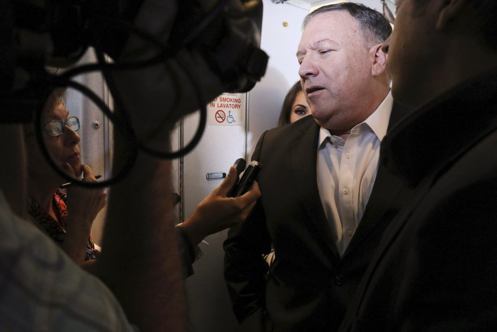 U.S. Secretary of State Mike Pompeo speaks with reporters aboard his plane en route to Thailand, before taking off from Andrews Air Force Base, Md., T...