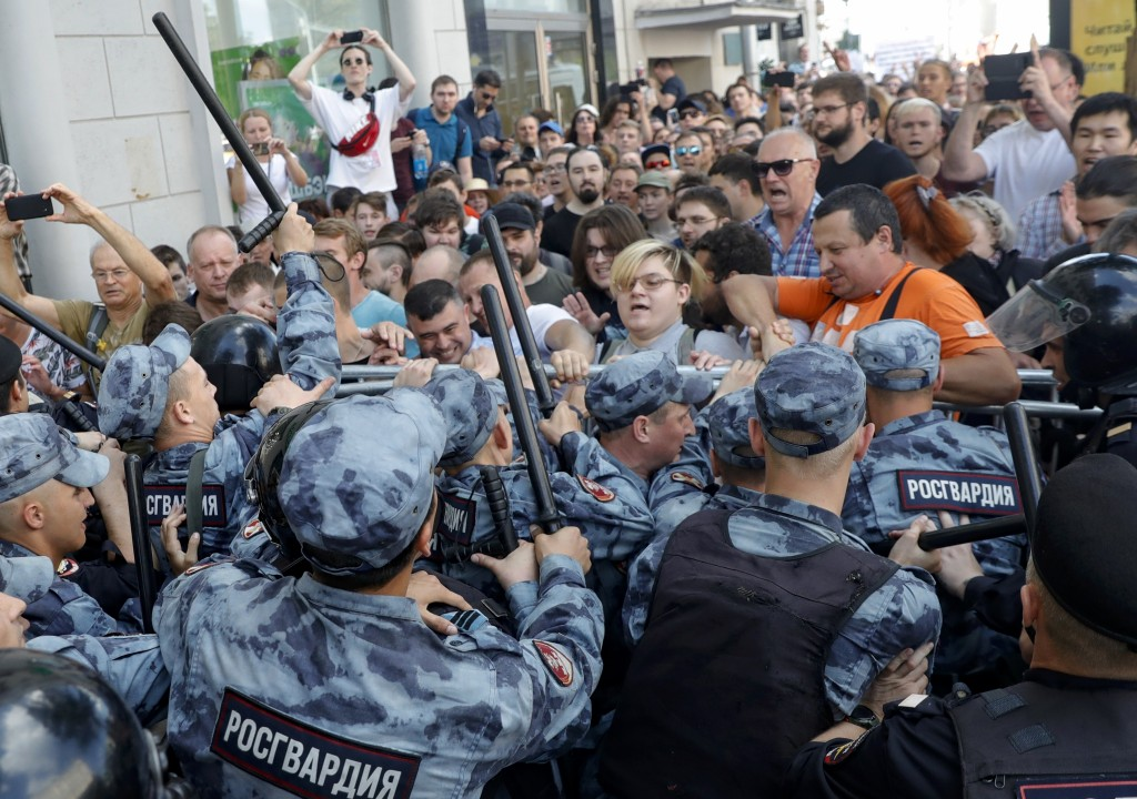 FILE - In this July 27, 2019, file photo, protesters clash with police during an unsanctioned rally in Moscow. The protest was the latest in a series ...