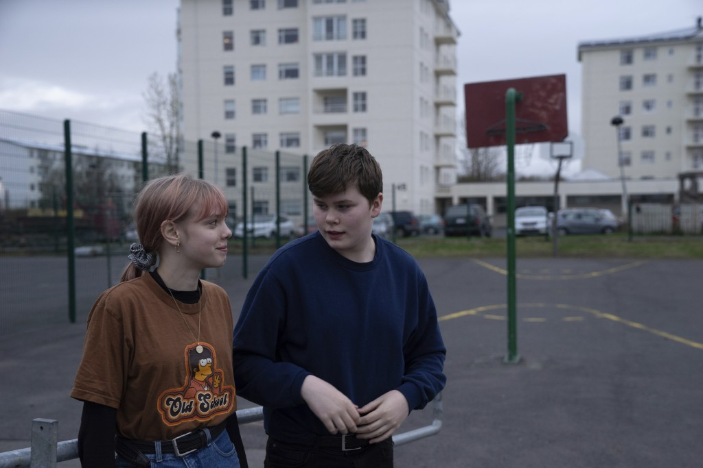This photo taken Monday, May 13, 2019, shows Karen Guttensen and Ingvar Ingolfsson, right, both 14-years old, outside the Tjornin youth center in Reyk