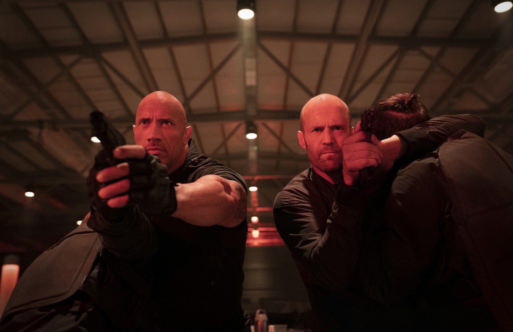 """This image released by Universal Pictures shows Dwayne Johnson, left, and Jason Statham in a scene from """"Fast & Furious Presents: Hobbs & Shaw."""" (Dani"""