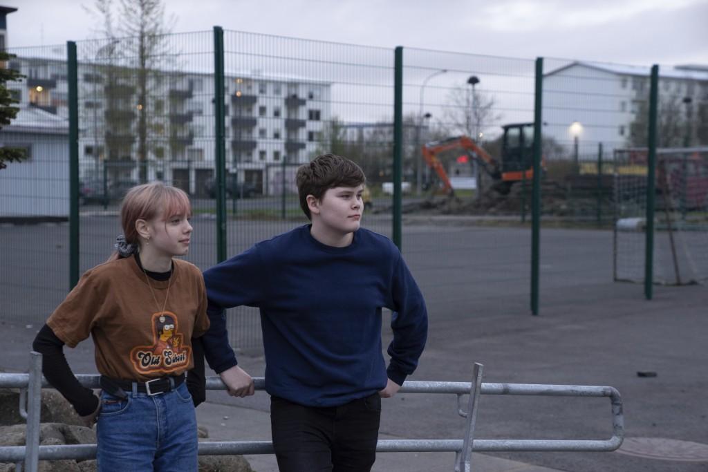 This photo taken Monday, May 13, 2019, Karen Guttensen and Ingvar Ingolfsson, right, both 14-years old, outside the Tjornin youth center in Reykjavik,
