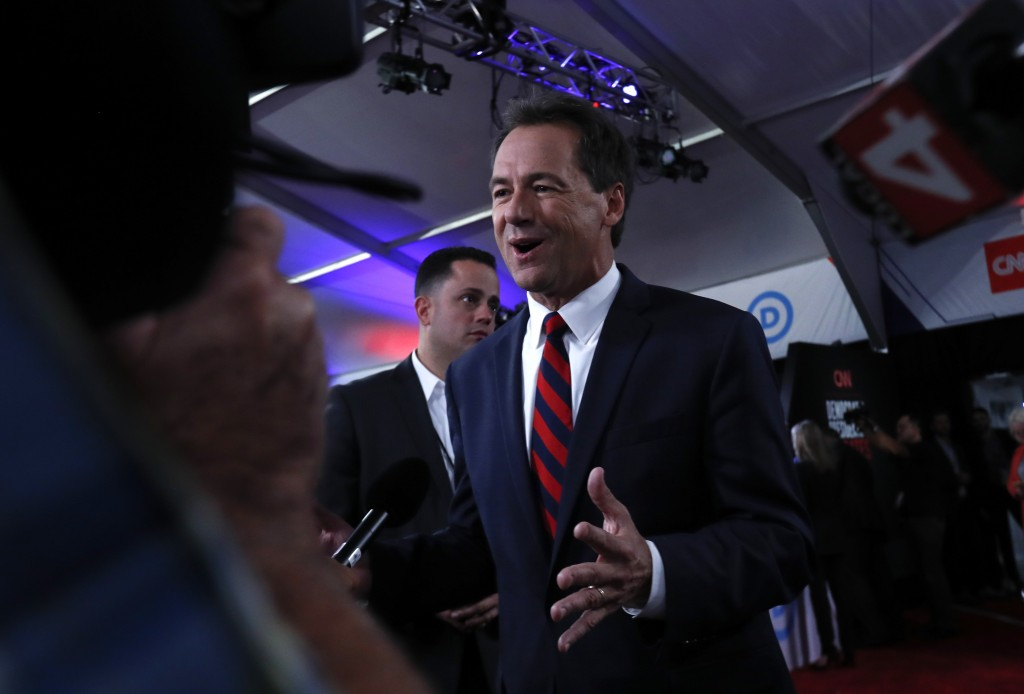 Montana Gov. Steve Bullock talks to reporters after the first of two Democratic presidential primary debates hosted by CNN Tuesday, July 30, 2019, in ...