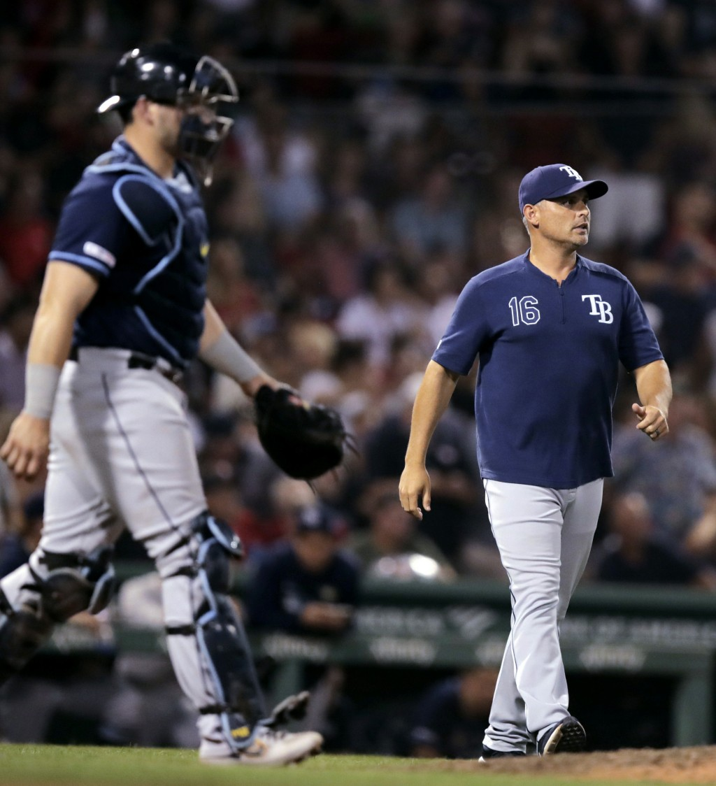 Tampa Bay Rays manager Kevin Cash and catcher Mike Zunino head to the mound for a visit during the seventh inning of the team's baseball game against ...