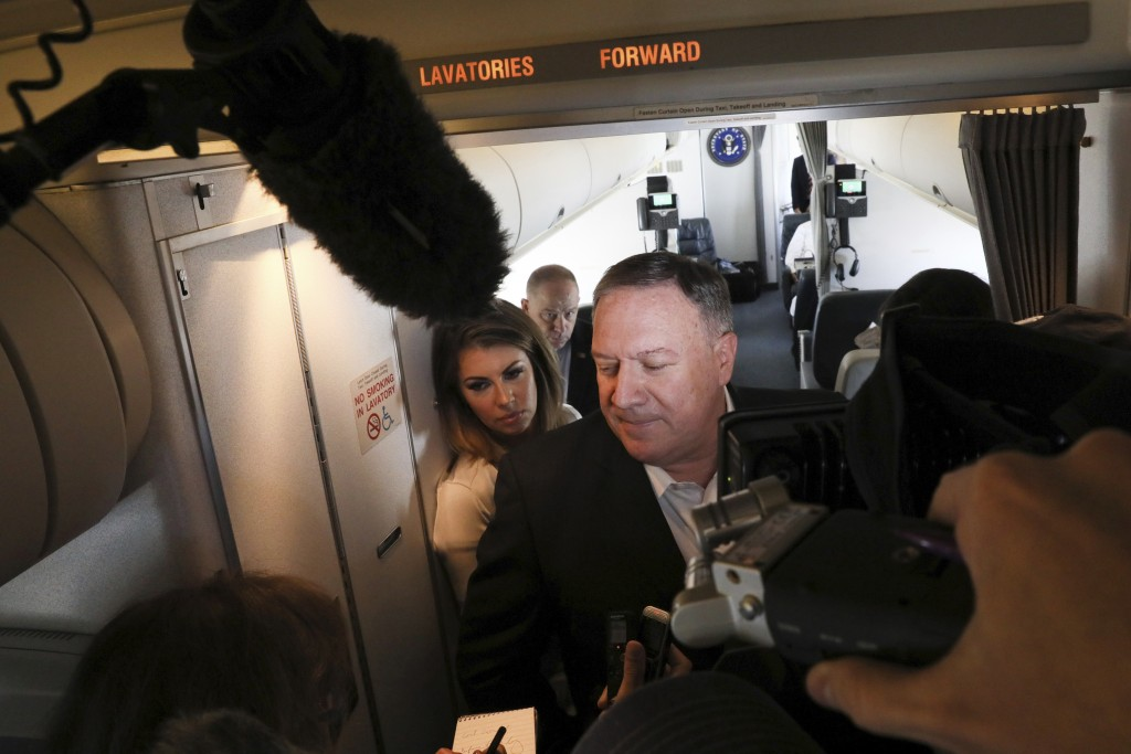 U.S. Secretary of State Mike Pompeo speaks with reporters aboard his plane en route to Thailand, before taking off from Andrews Air Force Base, Md., T