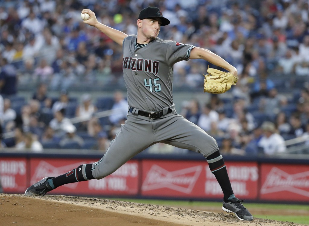 Arizona Diamondbacks' Taylor Clarke delivers a pitch during the third inning of the team's baseball game against the New York Yankees on Tuesday, July...
