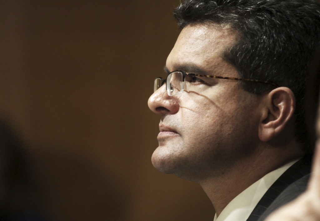 FILE - In this Sept. 29, 2015 file photo, Resident Commissioner Pedro Pierluisi, D-P.R., testifies before the Senate Finance Committee hearing on Puer...