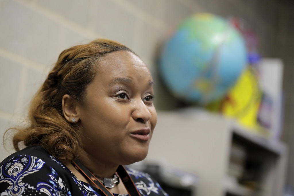 In a photo taken Tuesday, July 2, 2019, New Song Community Learning Center principal Lisa Brown talks to The Associated Press about programs at her ac...