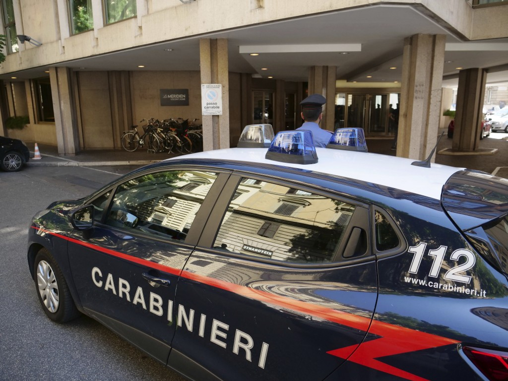A police car stations in front of the Meridien hotel in Rome, where two suspects from California, Finnegan Lee Elder, 19, and Gabriel Christian Natale...