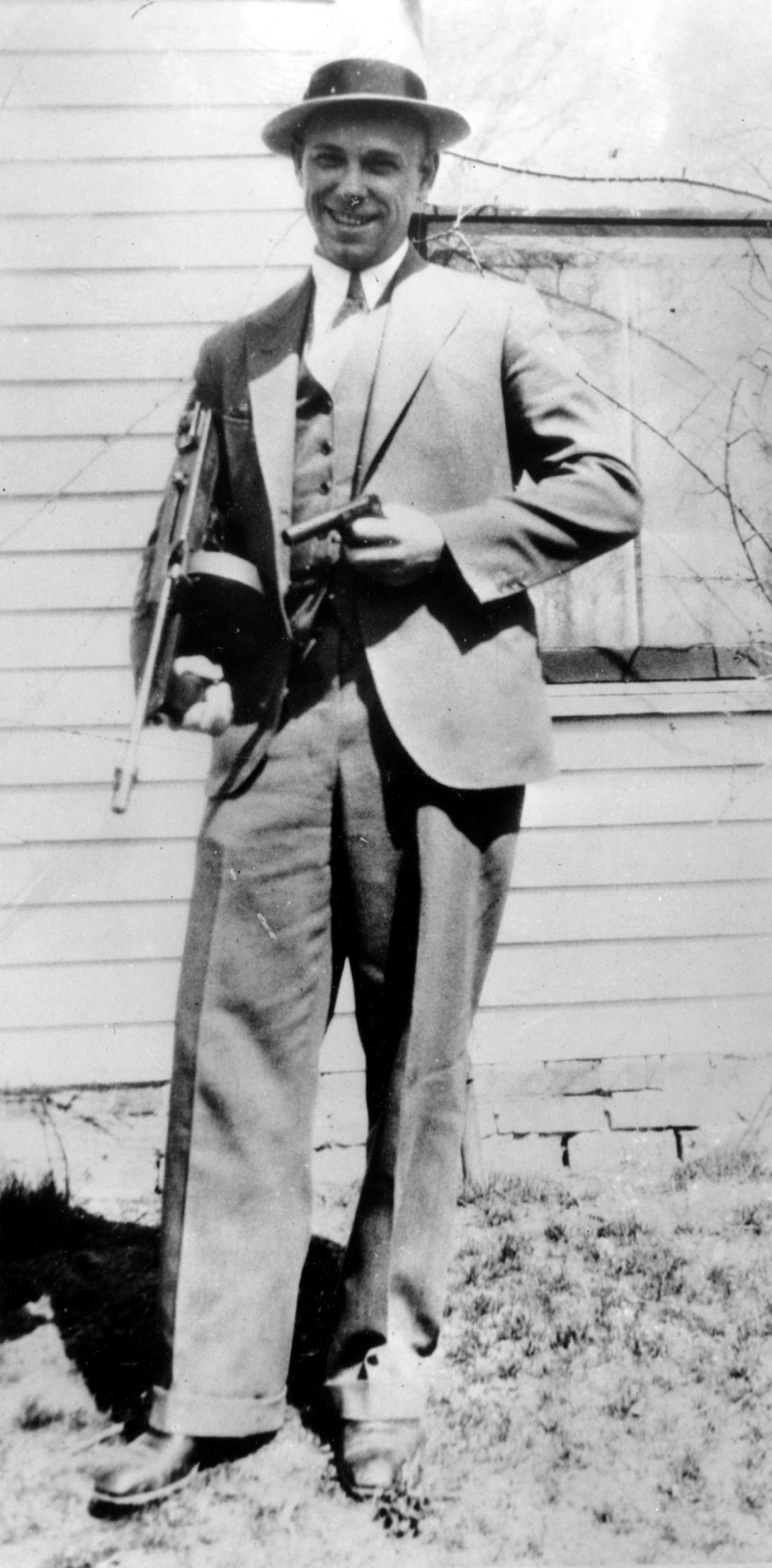 FILE - This is a 1934 file photo of desperado John Dillinger near Moore, Ind. The body of the 1930s gangster is set to be exhumed from an Indianapolis