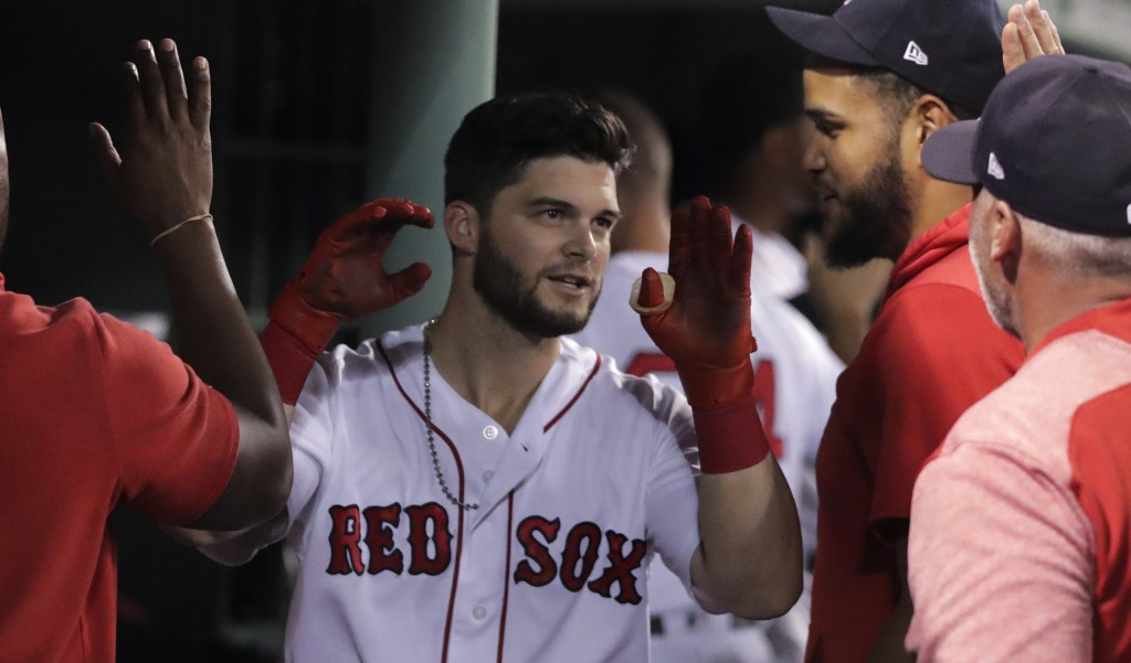 Boston Red Sox's Andrew Benintendi is congratulated after his two-run home run during the fifth inning of the team's baseball game against the Tampa B...