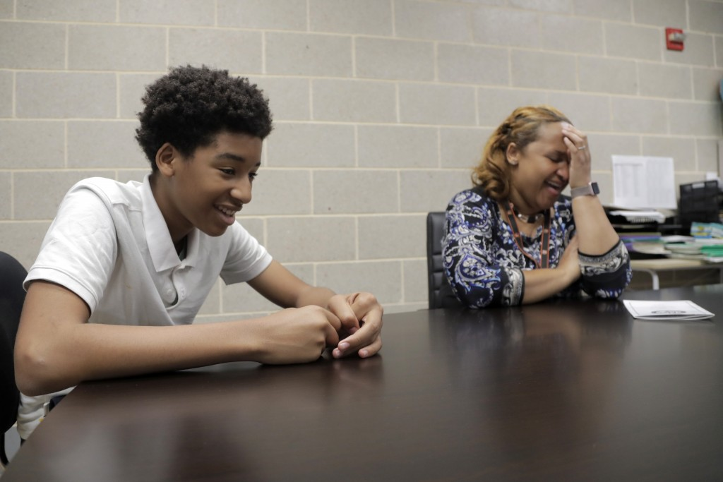 In a photo taken Tuesday, July 2, 2019, New Song Community Learning Center principal Lisa Brown, right, reacts as Kameryn Wylie, 13, a 7th grade stude...