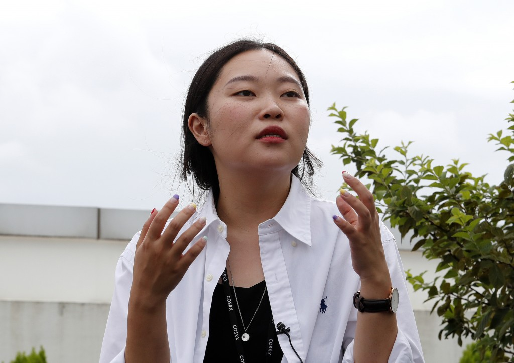 In this July 30, 2019, photo, Lee Kyung Eon, 26, speaks during an interview in Bundang, South Korea. When Lee and her friend recently scrapped their p...