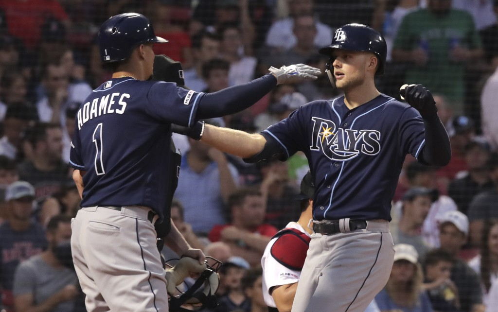 Tampa Bay Rays' Austin Meadows, right, is congratulated by Willy Adames (1) after his three-run home run off Boston Red Sox starting pitcher Rick Porc...
