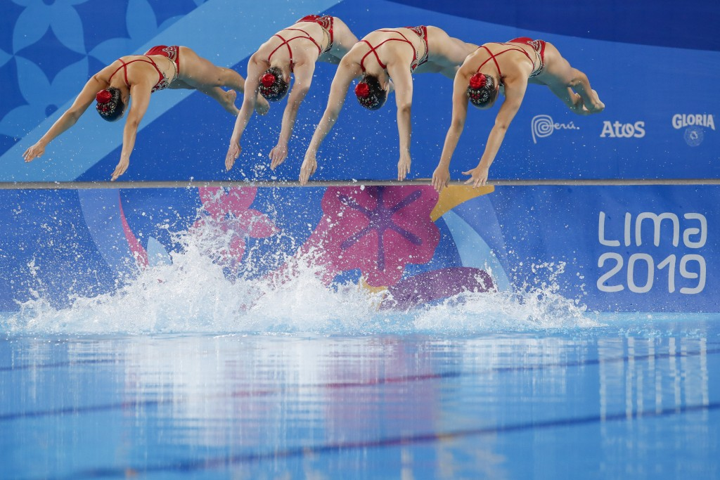 Members of Canada's artistic swimming team compete for the gold medal in the free routine event at the Pan American Games in Lima, Peru, Wednesday, Ju...