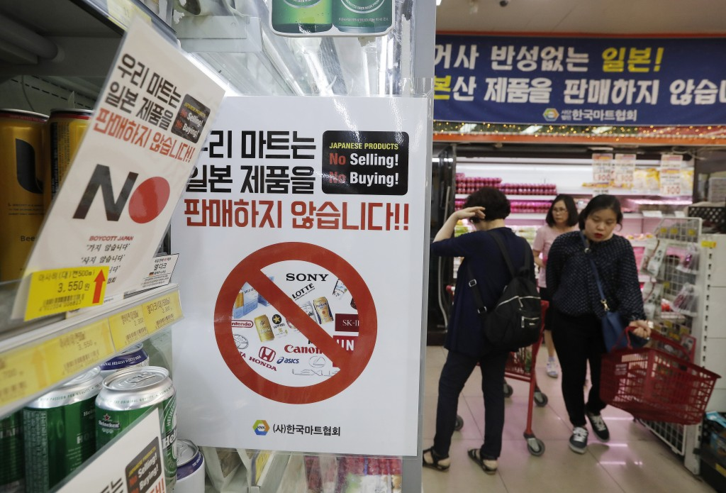 In this July 9, 2019, photo, notices campaigning for a boycott of Japanese-made products is displayed at a store in Seoul, South Korea. The signs read