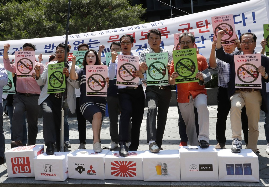 In this July 5, 2019, photo, South Korean small and medium-sized business owners stage a rally calling for a boycott of Japanese products in front of