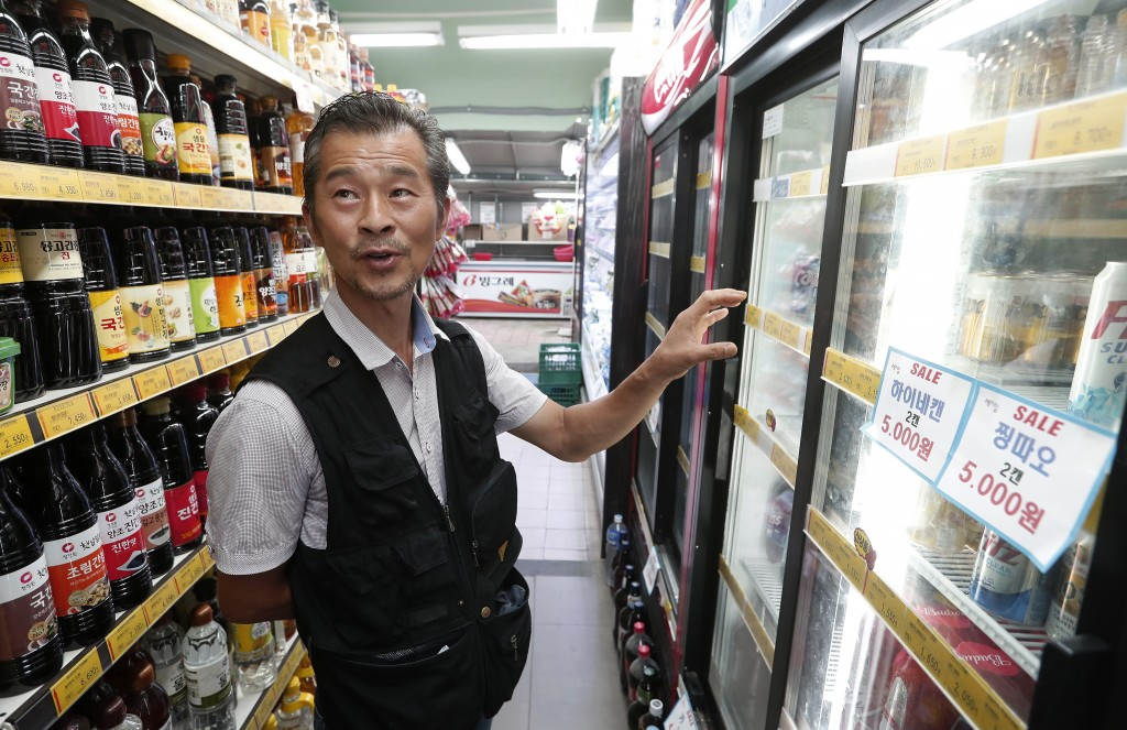 In this July 30, 2019, photo, Dan Kil-su, 51 and owner of Seoul's Heemang (Hope) supermarket who removed all Japanese products from store shelves on J