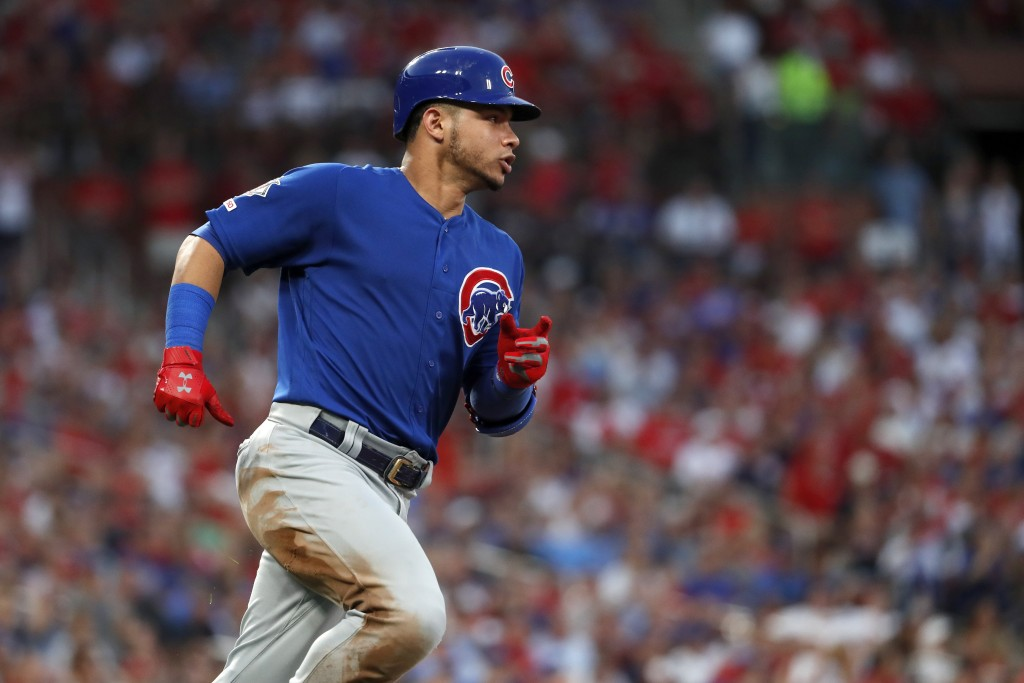 Chicago Cubs' Willson Contreras rounds first on a single during the third inning of the team's baseball game against the St. Louis Cardinals on Wednes...