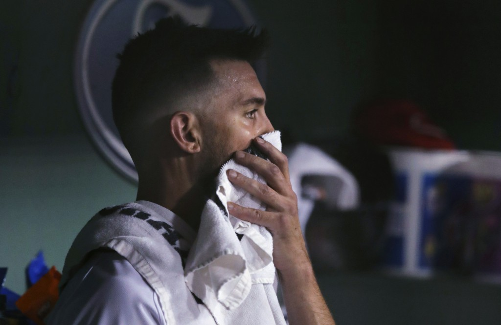 Boston Red Sox starting pitcher Rick Porcello sits in the dugout after being taken out of the baseball game, following a home run by Tampa Bay Rays' W...
