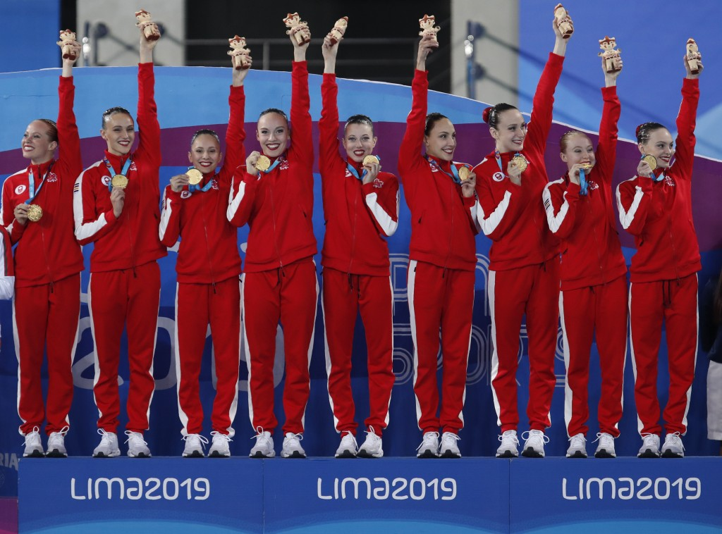 Canada's artistic swimming team celebrates after receiving their gold medals in the finals of team competition free artistic swimming at the Pan Ameri...