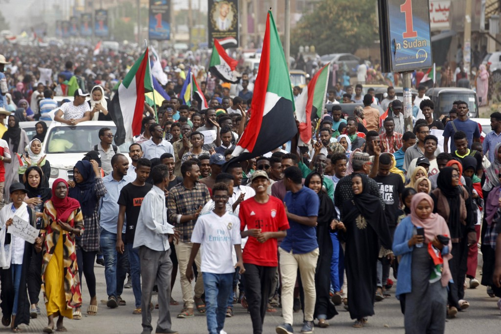 Sudanese protesters march during a demonstration in the capital Khartoum, Sudan, Thursday, Aug. 1, 2019. Sudanese pro-democracy activists have posted ...