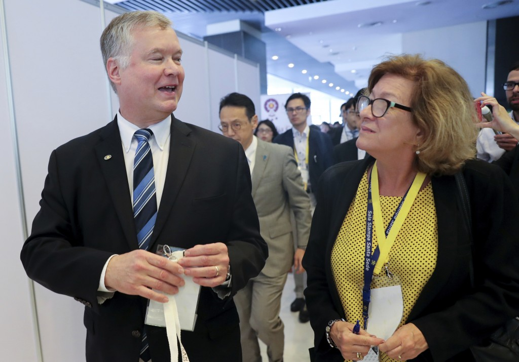 U.S. special envoy to North Korea Stephen Biegun, left, is trailed by reporters as he walks at the media center during the ASEAN and East Asia summits