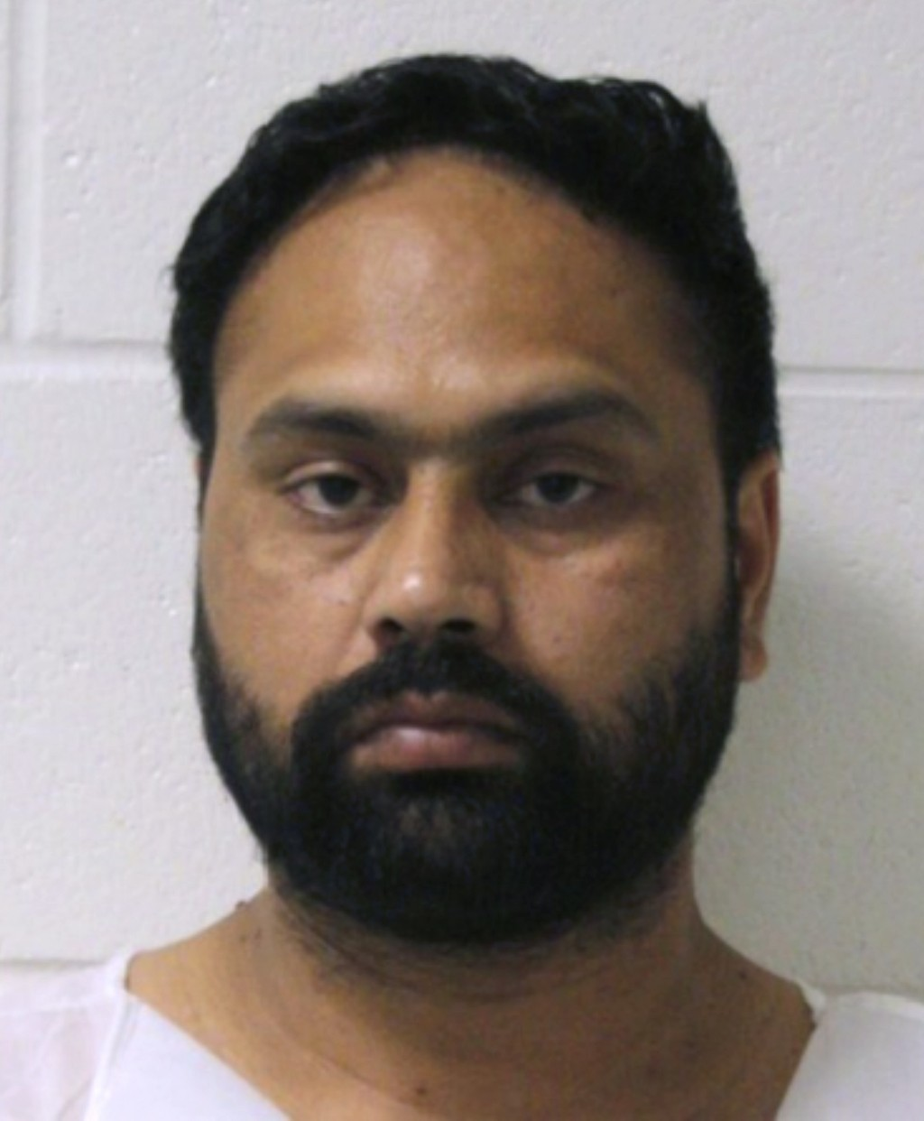 FILE - This booking photo released by the Branford Police Department shows Gurpreet Singh, arrested Tuesday, July 2, 2019, in Branford, Conn. Butler C...