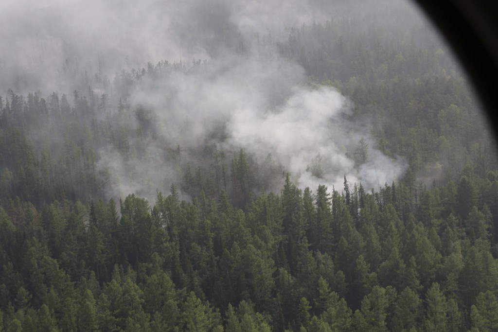This photo taken on Monday, July 29, 2019 and released by Press Service of the Ministry of Forestry of the Krasnoyarsk Territory, shows an air view of...