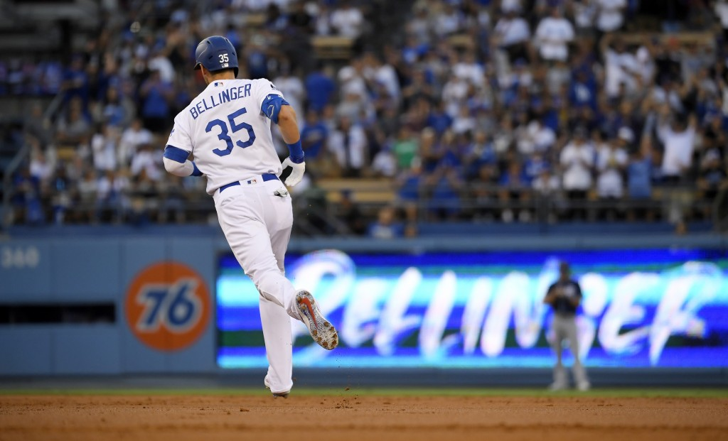 Los Angeles Dodgers' Cody Bellinger heads to second after hitting a solo home run during the second inning of the team's baseball game against the San...