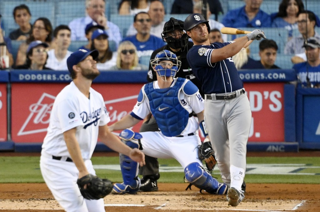San Diego Padres' Hunter Renfroe watches his solo home run off Los Angeles Dodgers starting pitcher Clayton Kershaw, left, during the second inning of...