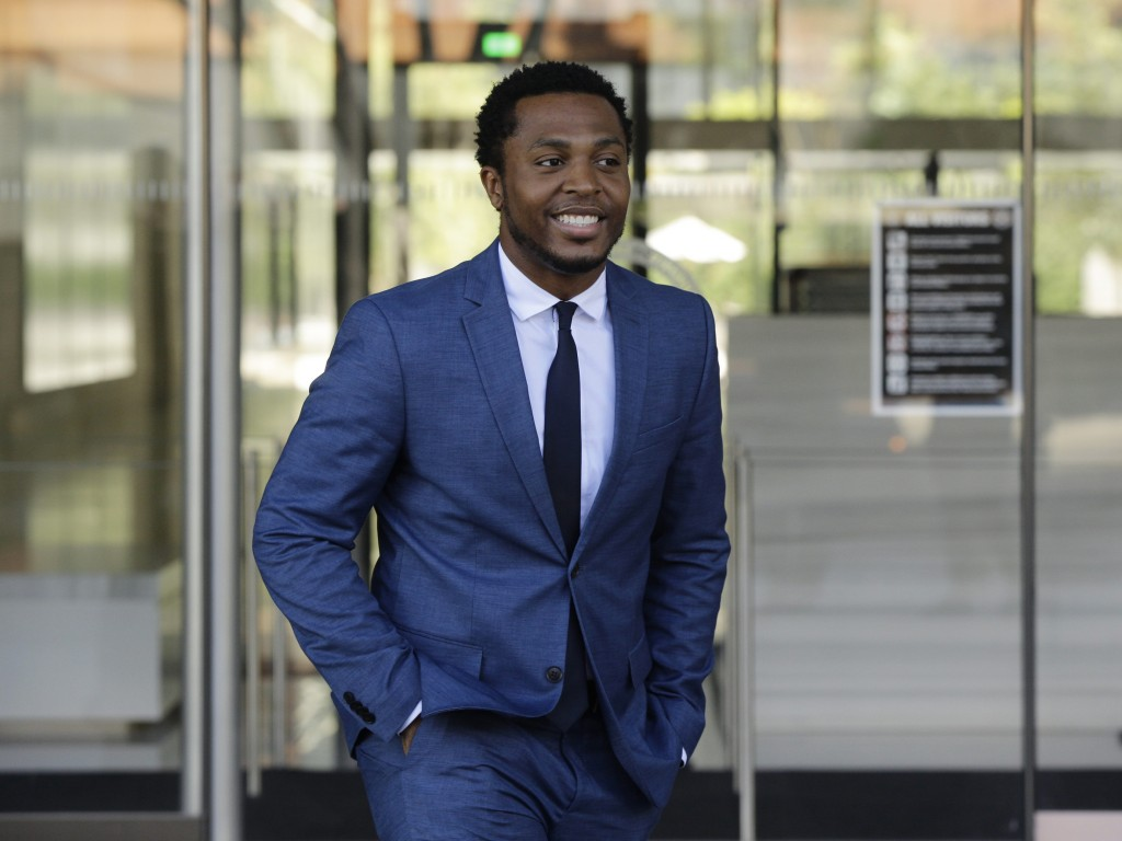 Rapper Marcus Gray smiles as he leaves the federal courthouse in Los Angeles Thursday, Aug. 1, 2019. A jury has decided that Katy Perry, her collabora...