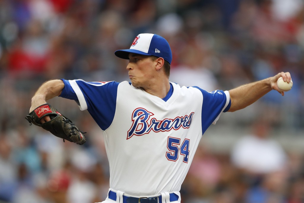 Atlanta Braves starting pitcher Max Fried works against the Cincinnati Reds in the first inning of a baseball game Thursday, Aug. 1, 2019, in Atlanta....