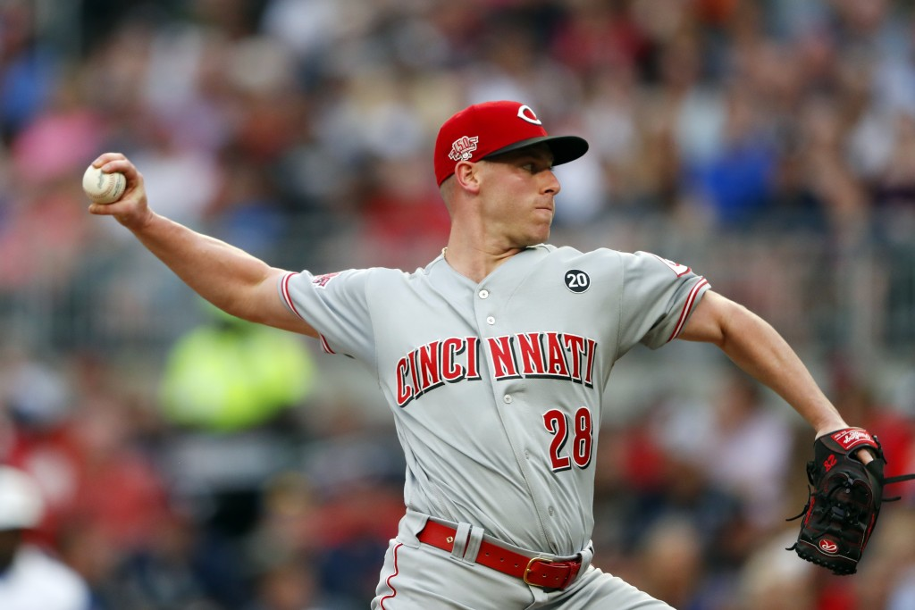 Cincinnati Reds starting pitcher Anthony DeSclafani works in the first inning of the team's baseball game against the Atlanta Braves on Thursday, Aug.