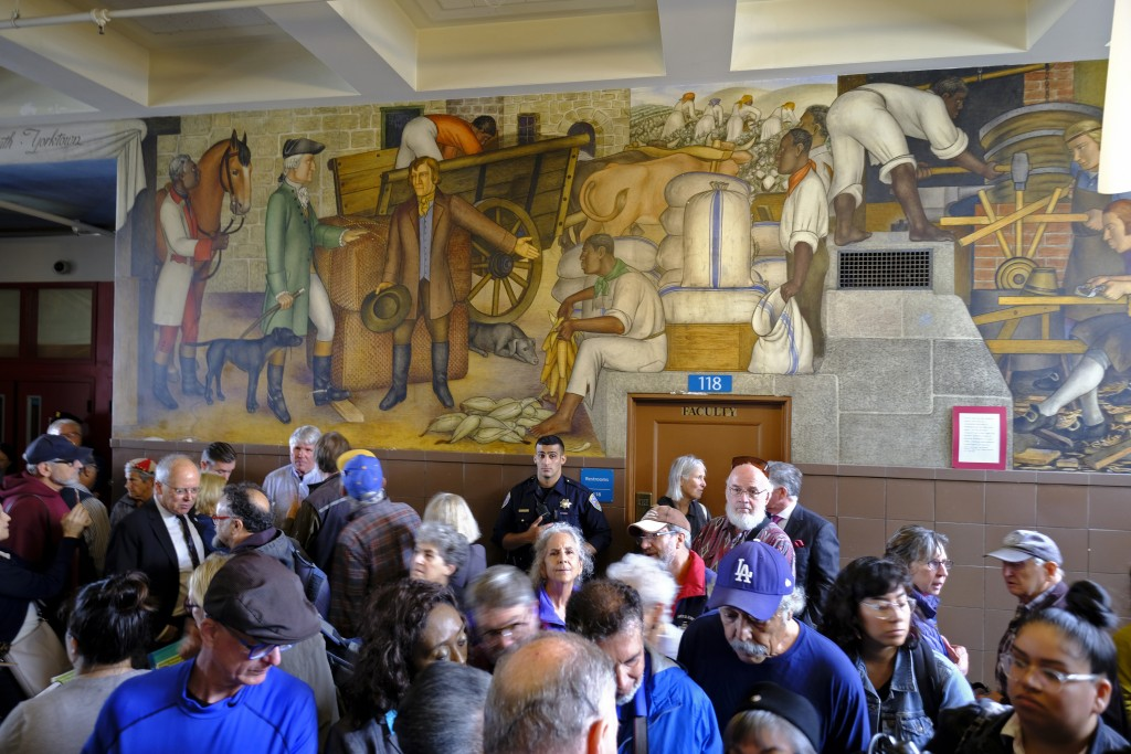 "People fill the main entryway of George Washington High School to view the controversial 13-panel, 1,600-square foot mural, the ""Life of Washington,"" ..."