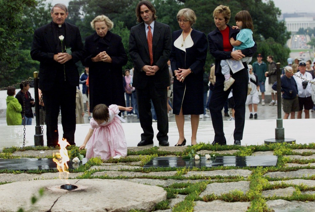 FILE - In this June 6, 2000 file photo, Robert F. Kennedy's granddaughter Saoirse Kennedy Hill places a white rose at the Eternal Flame, President Joh