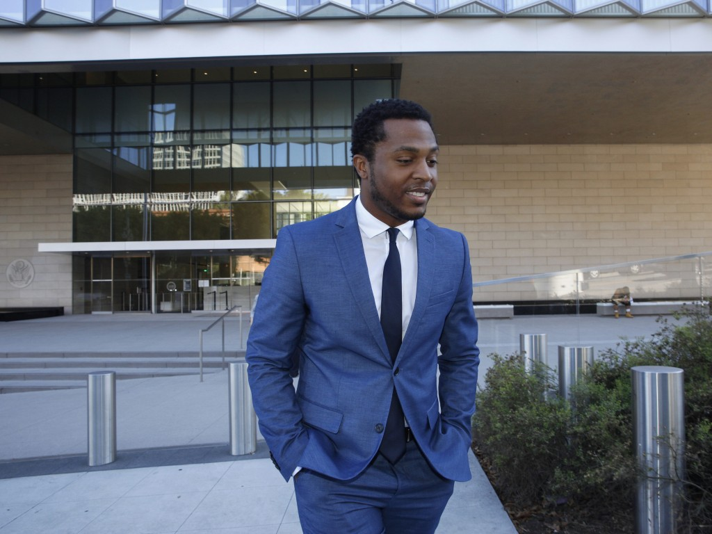 Rapper Marcus Gray leaves the federal courthouse in Los Angeles, Thursday, Aug. 1, 2019. A jury has decided that Katy Perry, her collaborators and her